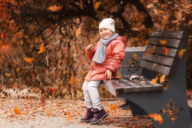 Pretty little girl in autumn park stock photos