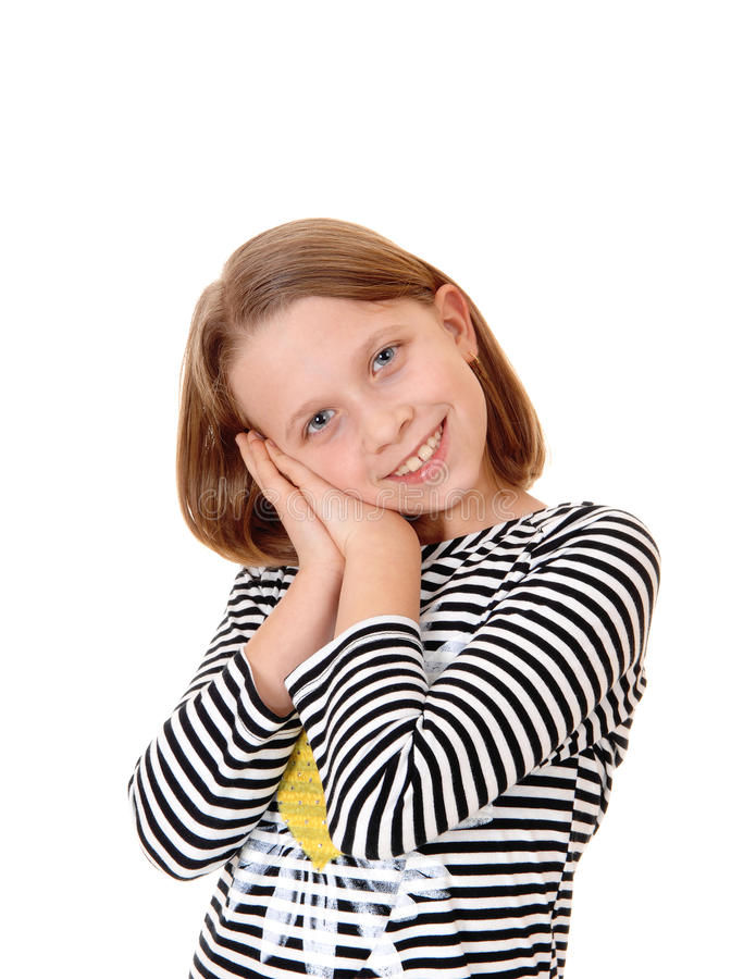 Pretty little girl. A beautiful young girl standing for white background with her hands together on her face and smiling royalty free stock image