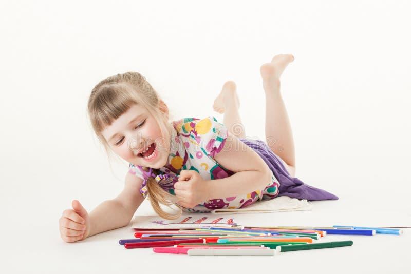 Pretty little girl choosing a felt-tip pen stock image