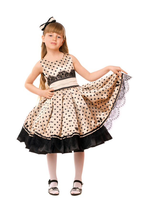 Pretty little girl in a dress. Isolated stock photo