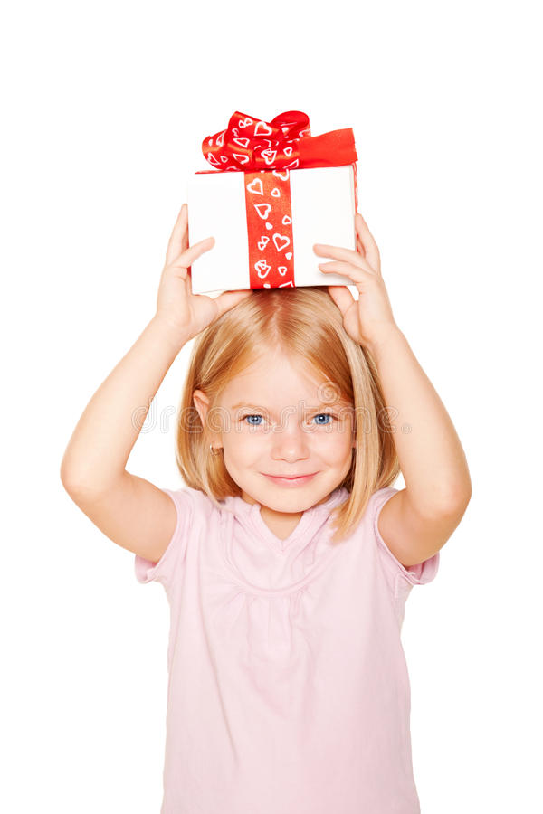 Pretty little girl with gift on head. royalty free stock photos