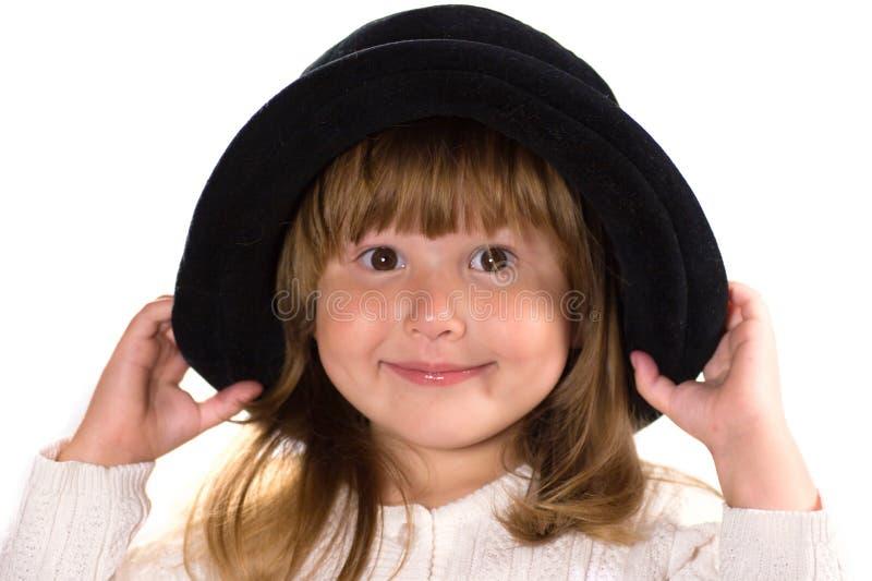 Pretty little girl in hat stock image
