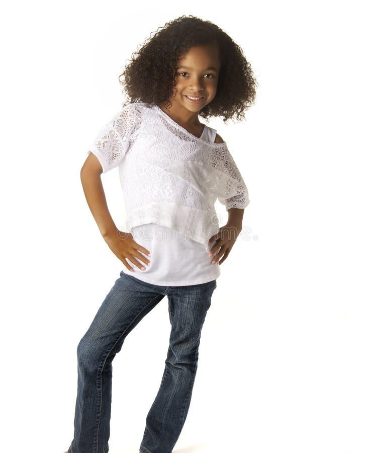 Pretty little girl isolated against white backgrou stock image