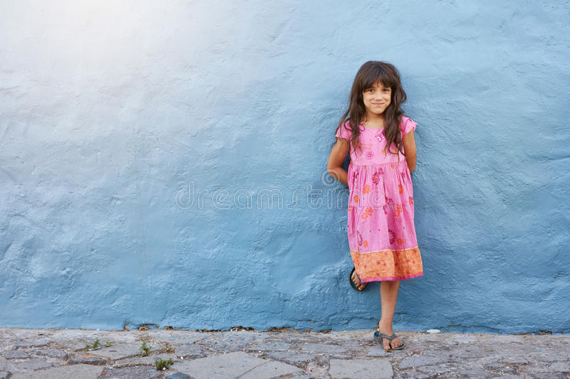 Pretty little girl looking at camera and smiling royalty free stock photos