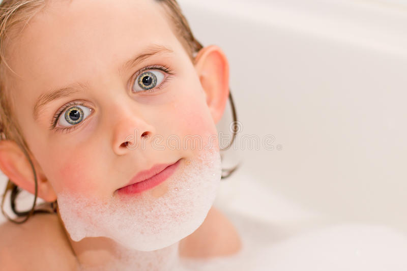 Pretty Little Girl Playing in the Bathtub stock image