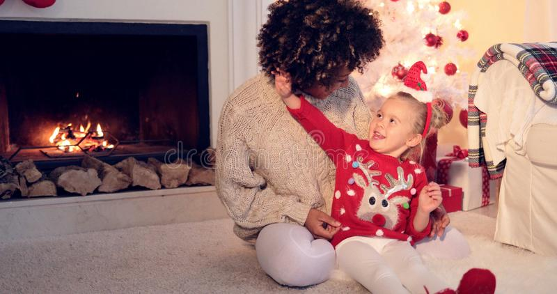 Pretty little girl plays with her mothers hair stock photos