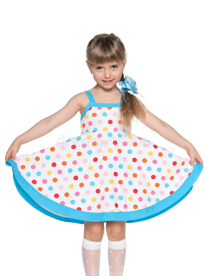 Pretty little girl in the polka dot dress stock images