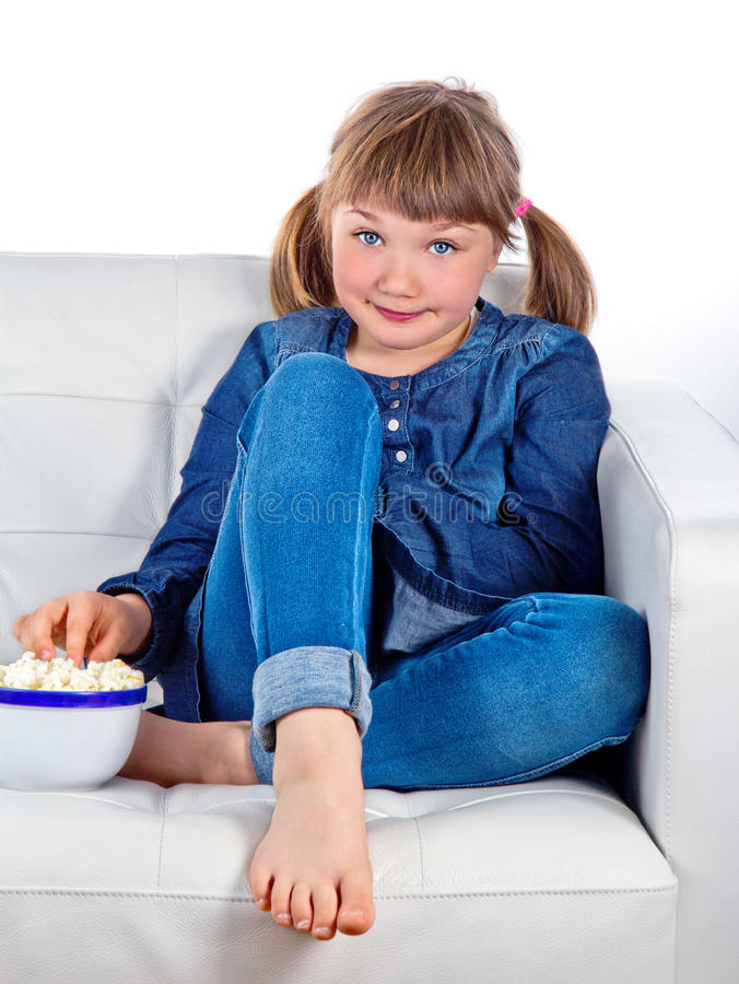 Pretty Little Girl Sitting On A Couch Stock Photo - Image ...