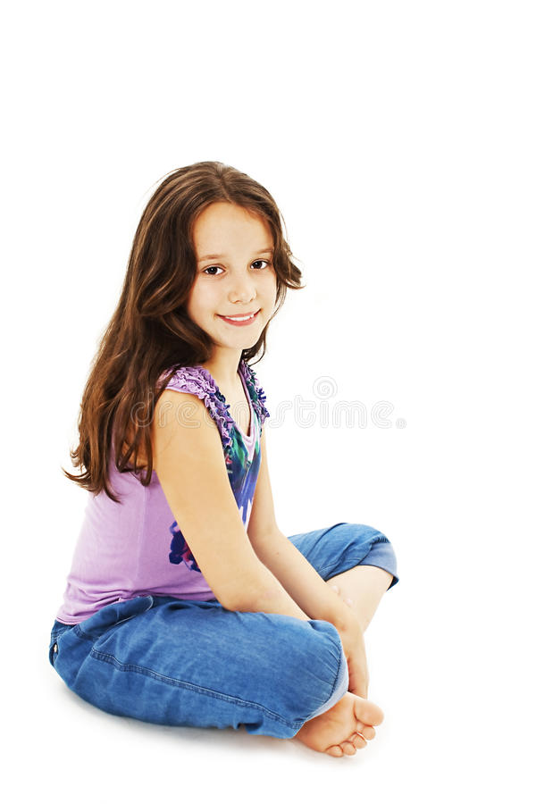 Pretty Little Girl Sitting On The Floor In Jeans Stock ...