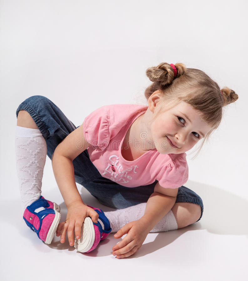 Pretty little girl sitting on the floor royalty free stock photo