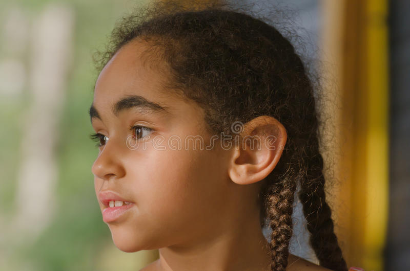 Pretty little girl staring off. In the distance stock photos