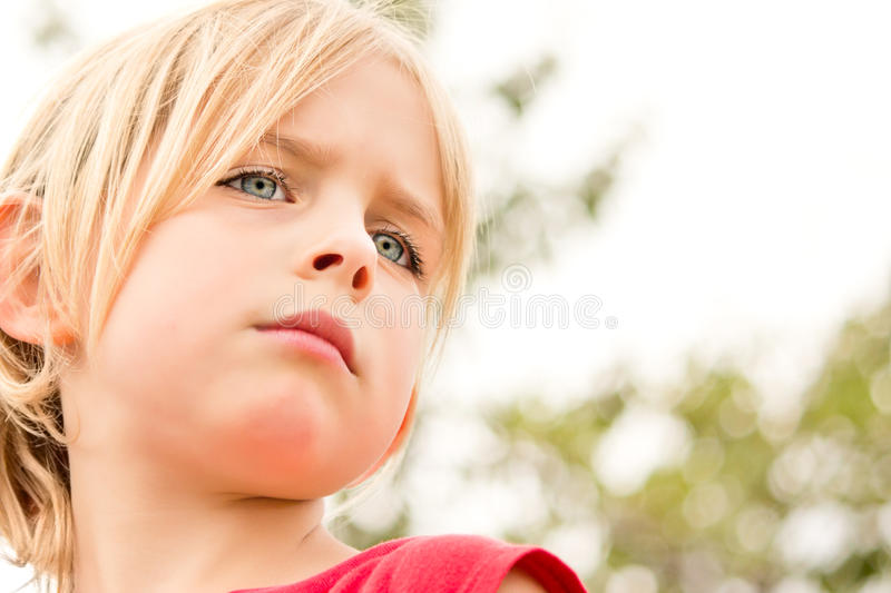 Pretty Little Girl Staring in Thought royalty free stock photos