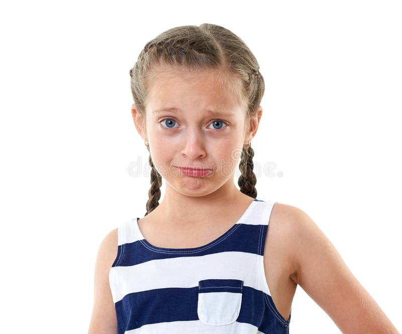 Pretty little girl in striped dress studio portrait, making a surprised face, white background royalty free stock photography