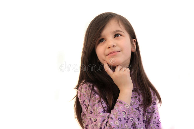 Pretty little girl thinking royalty free stock image