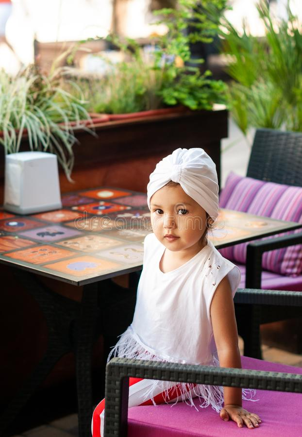 Pretty little girl with white turban on her head stock image