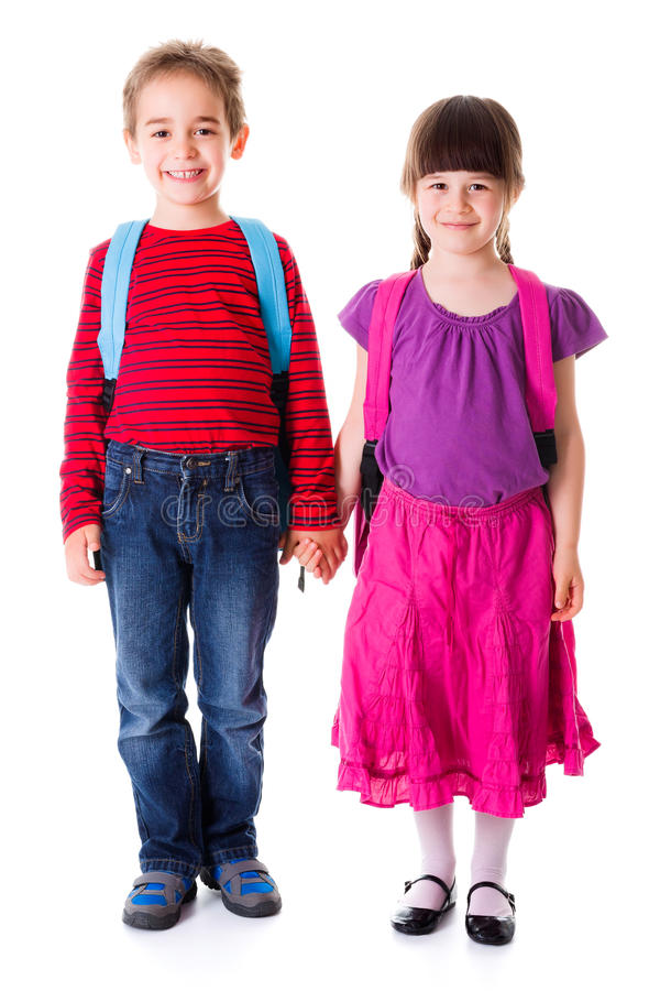 Pretty little schoolgirl and schoolboy royalty free stock photography
