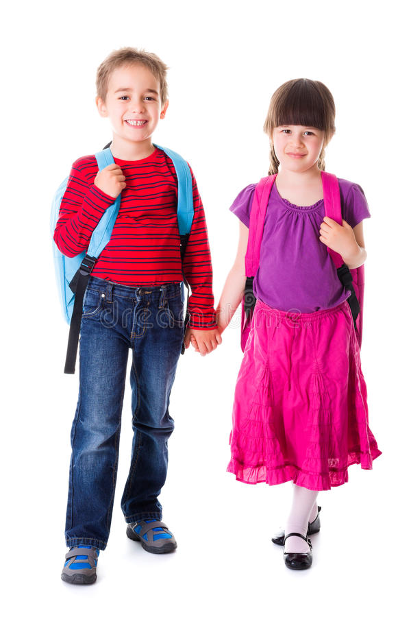 Pretty little schoolgirl and schoolboy royalty free stock photos