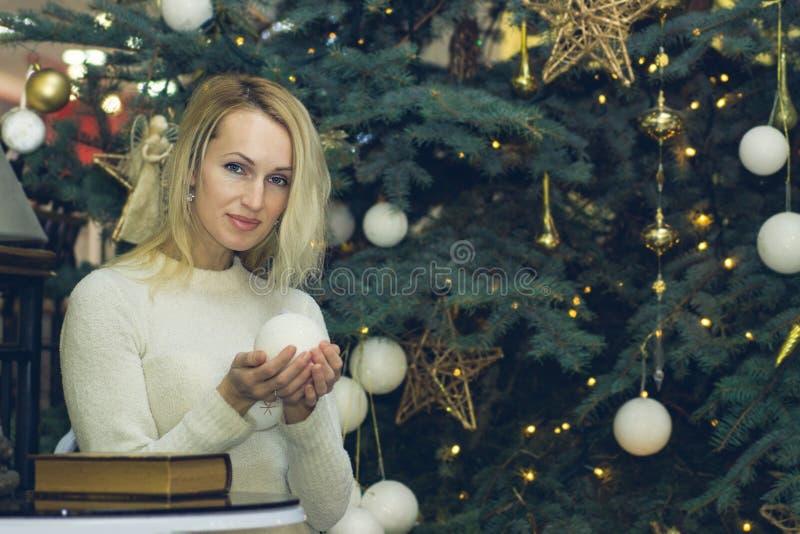 Pretty long hair girl celebration Christmas. Pretty blonde long hair girl celebration Christmas royalty free stock photography