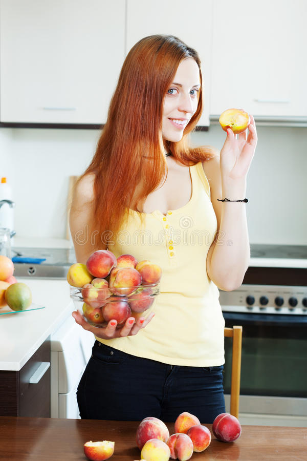 Pretty Long-haired Woman Holding Peaches Stock Photo