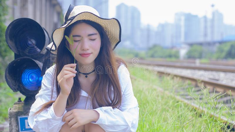 Pure and lovely Asian girl. Pretty lovely girl and rail background. A slightly retro portrait. Play on the rails royalty free stock photos