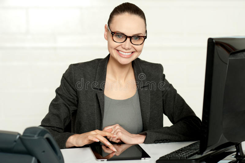 Pretty manager working on wireless tablet device