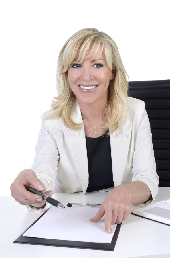 Pretty mature business woman with contract to sign stock photos