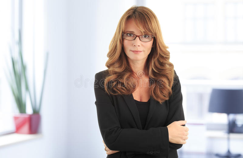 pretty mature business woman smiling confidently stock image - image