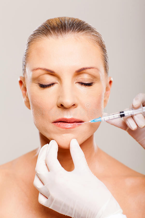 Download Mature lips injection stock photo. Image of lifting, lips - 29801214