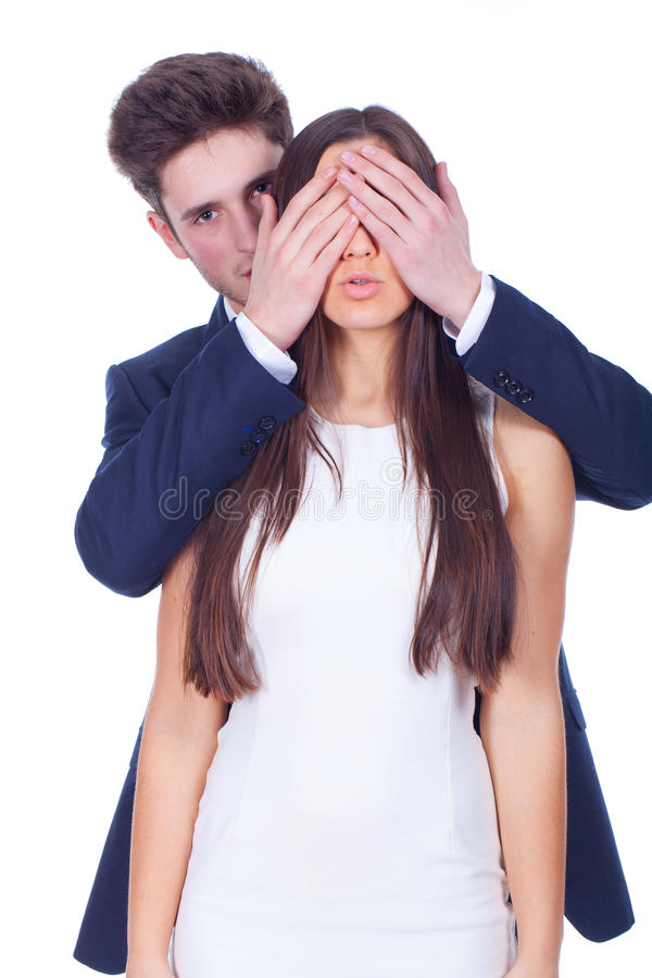Man covering woman eyes royalty free stock photography