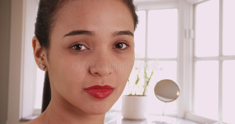 Pretty Mexican woman looking at camera stock photo