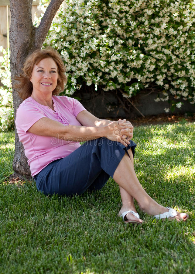 Pretty middle-aged woman outdoors royalty free stock images