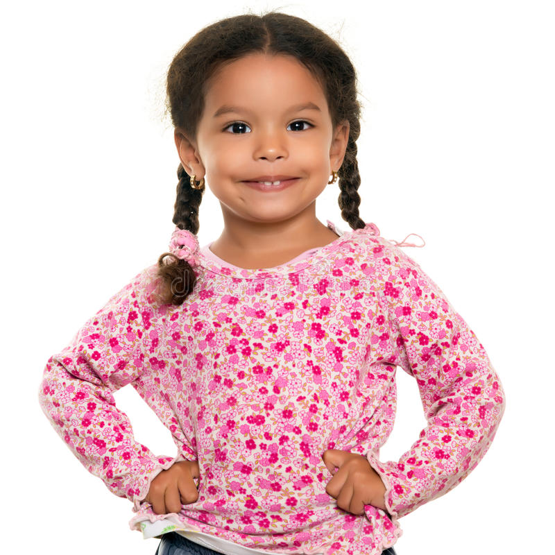 Pretty mixed race small girl isolated on white. Pretty mixed race small girl isolated on a white background royalty free stock photo