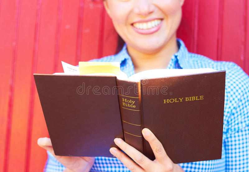 Pretty Mixed Race Woman Reading Holy Bible stock images