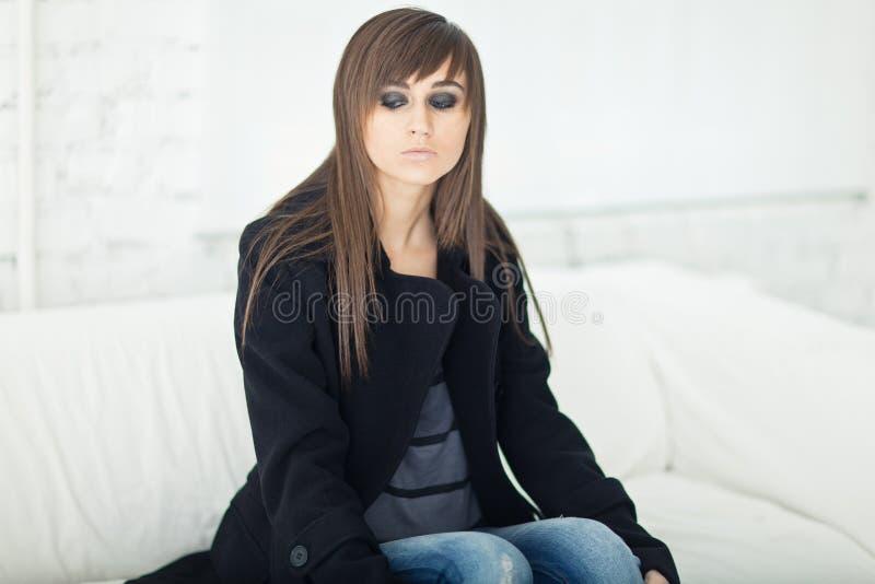Pretty Model In A Black Coat Stock Photos
