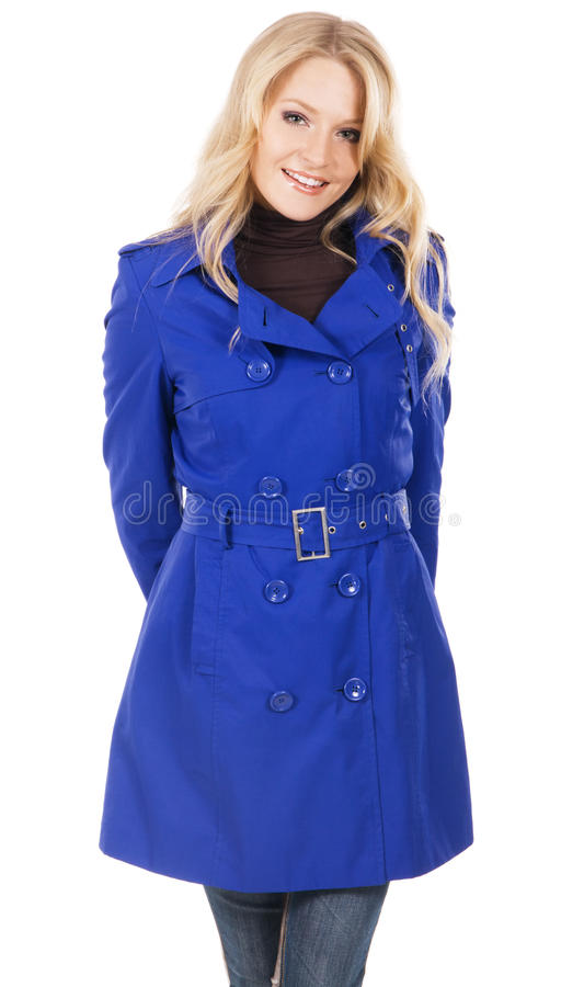 Pretty model in a blue coat stock images