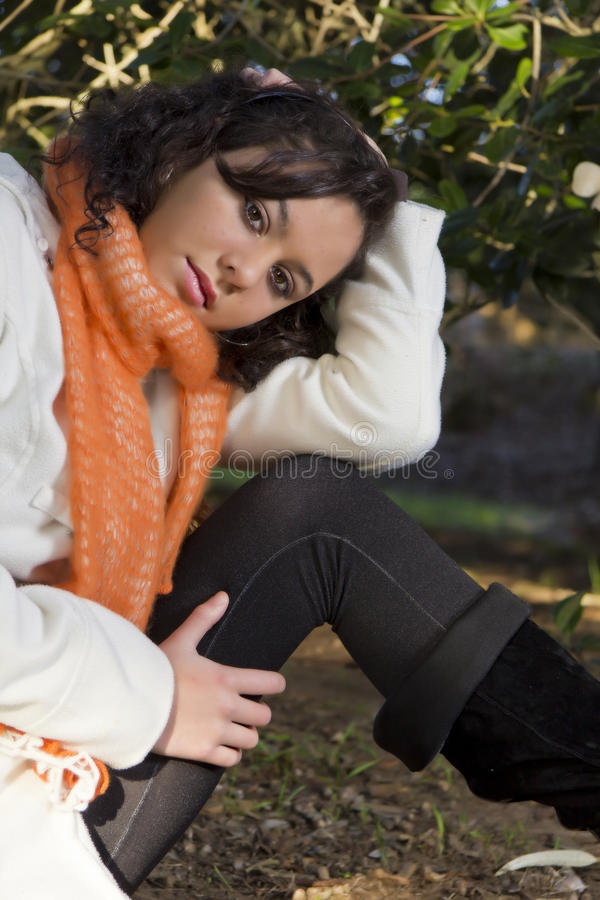 Download Pretty Model With Brown Eyes Sitting Outside Stock Image - Image: 32297889