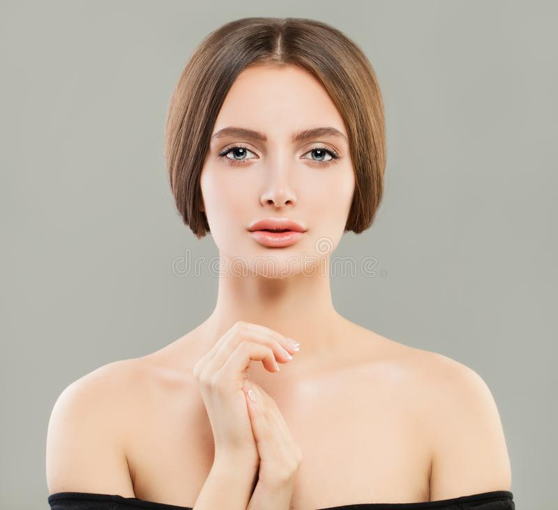 Pretty model woman with clear skin and healthy hair. Skincare and facial treatment concept stock photos