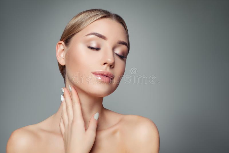 Pretty model woman relaxing and smiling. Perfect girl with clear skin. Massage, treatment and cosmetology concept.  stock photography