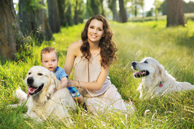 Pretty mother with child and dogs royalty free stock photography