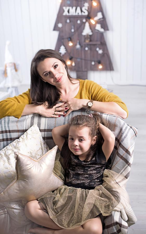 Pretty mother posing with a daughter royalty free stock photo