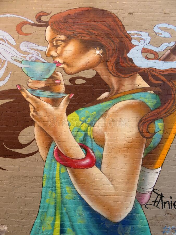 Free Pretty Mural Of A Woman Sipping Coffee In Georgetown Royalty Free Stock Photography - 190390367