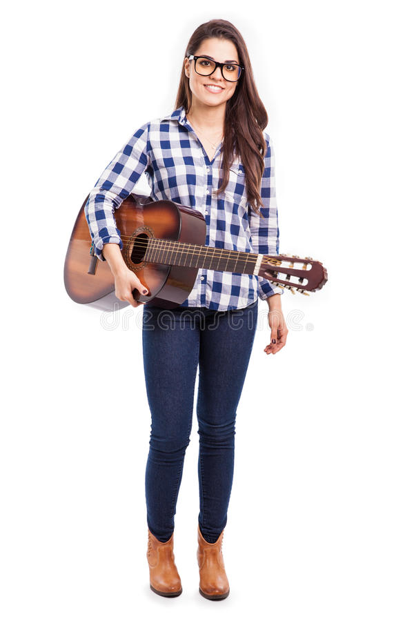 Pretty musician with a guitar royalty free stock photography