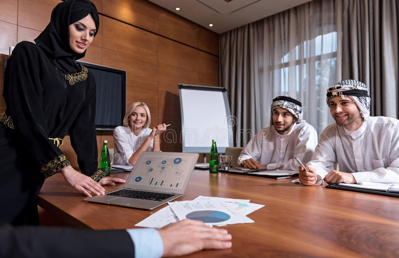 Pretty Muslim woman showing the diagram stock photos