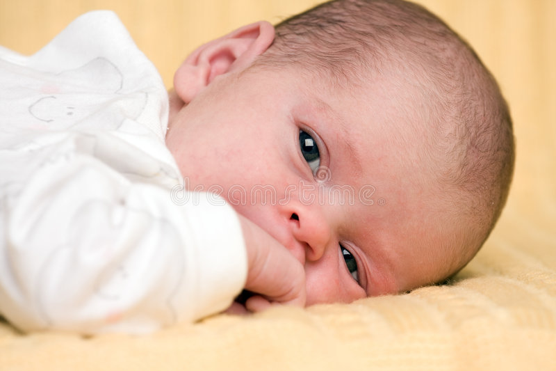 Pretty newborn baby. stock photography