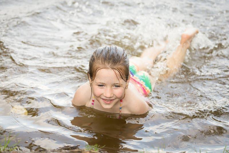 Pretty nice little girl swimming in lake. Pretty nice little girl swimming in summer lake royalty free stock image