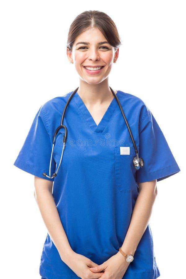 Pretty nurse wearing scrubs stock photos