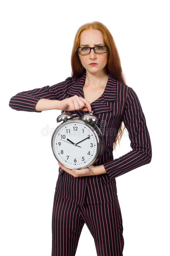 The pretty office employee with alarm clock. Pretty office employee with alarm clock isolated on white stock image