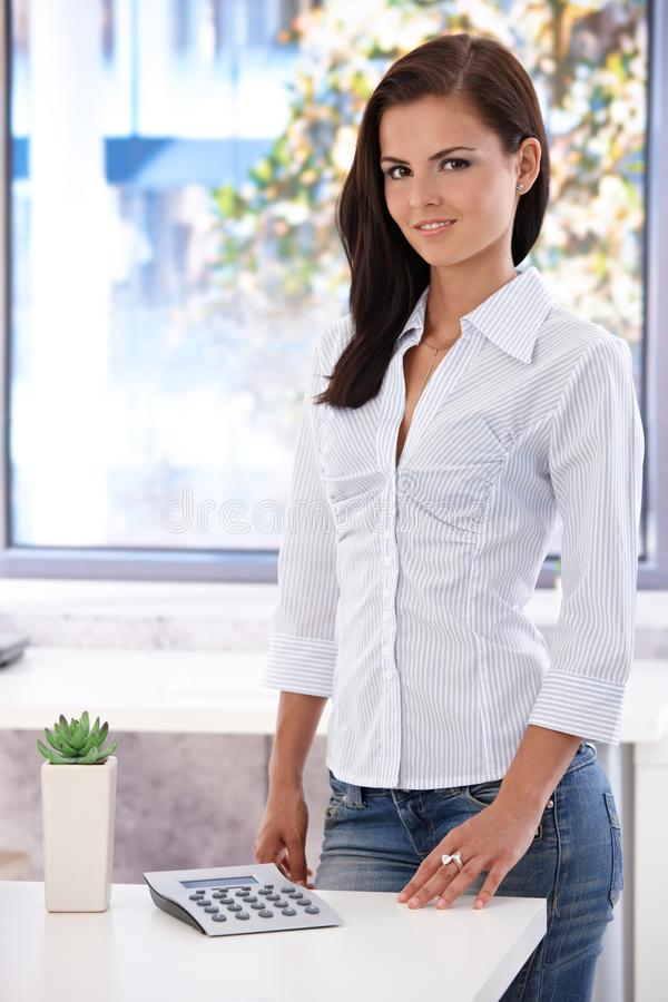 Free Pretty Office Worker Smiling In Bright Office Stock Images - 24455834