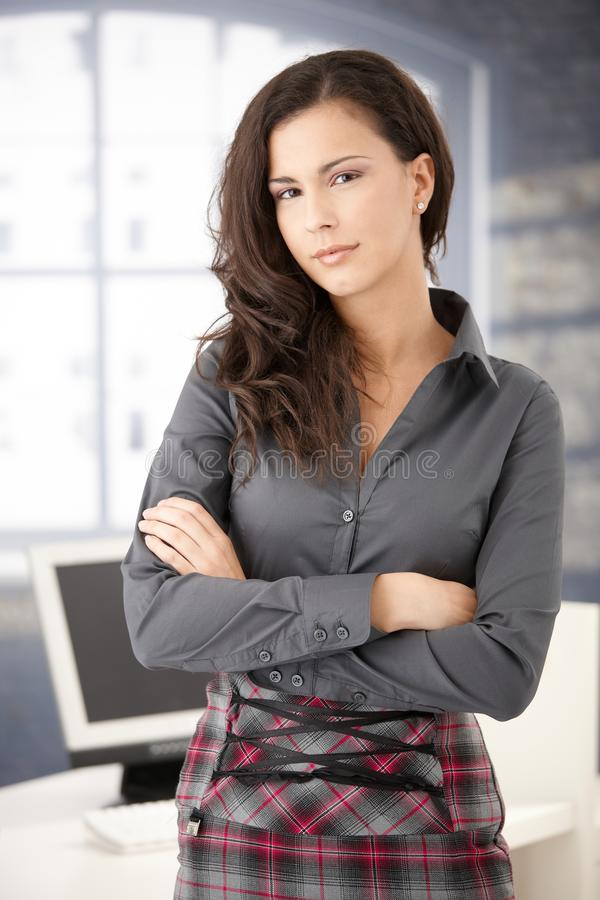 Free Pretty Office Worker Standing In Office Smiling Stock Images - 17740894