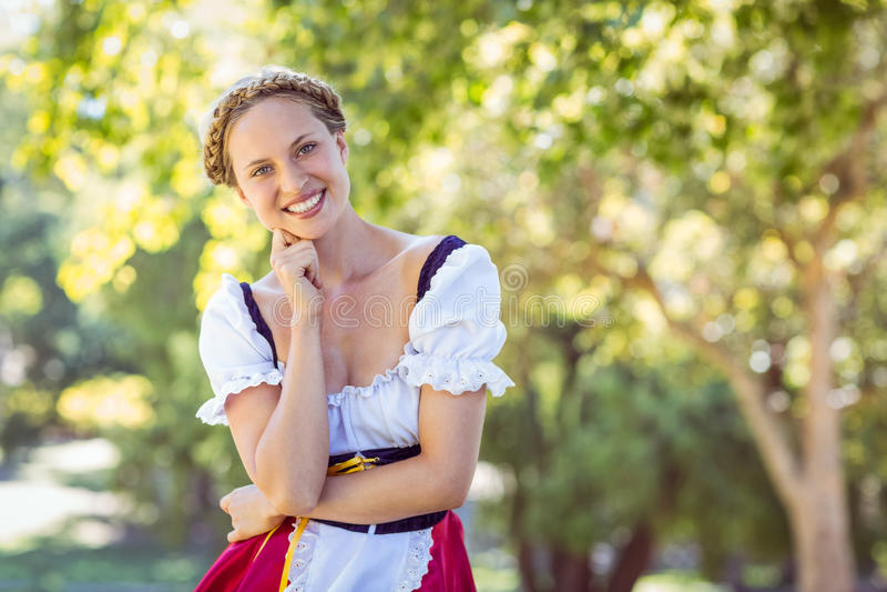 Pretty oktoberfest blonde smiling in the park stock photos